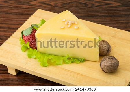 Parmesan cheese triangle with strawberry and wallnuts - stock photo