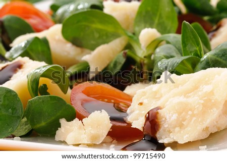 Parmesan cheese with balsamic vinegar and vegetables - stock photo