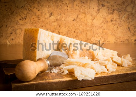 Parmesan cheese with knife - stock photo
