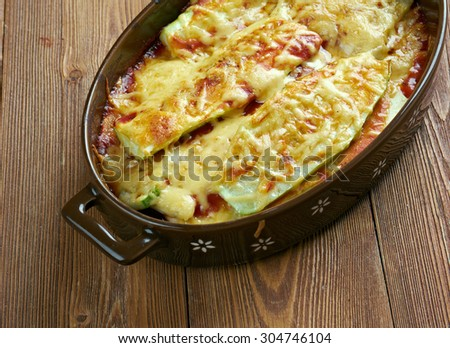 Parmigiana di zucchine - zucchini with cheese and tomatoes.Italian food