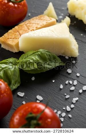 Parmigiano on black stone - stock photo