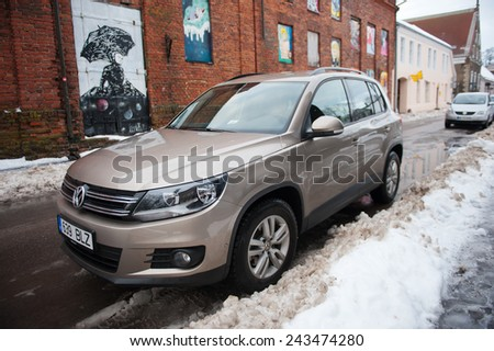 PARNU - DEC 31: VW Tiguan  on Dec. 31, 2014 in Parnu, Estonia. Volkswagen Tiguan is a compact crossover vehicle (CUV) manufactured by German automaker Volkswagen using the PQ35 platform of the VW Golf - stock photo