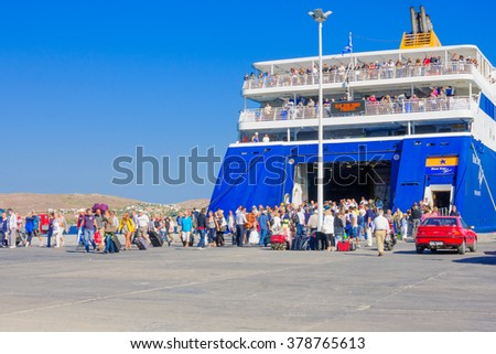PAROS, GREECE - OCTOBER 02, 2011: Port scene, with ferry ship, vehicles and passengers, in Paros, Paros Island, Greece
