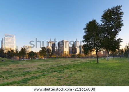 Parque Araucano and skyline of office buildings at Nueva Las Condes business center, Las Condes, Santiago de Chile - stock photo