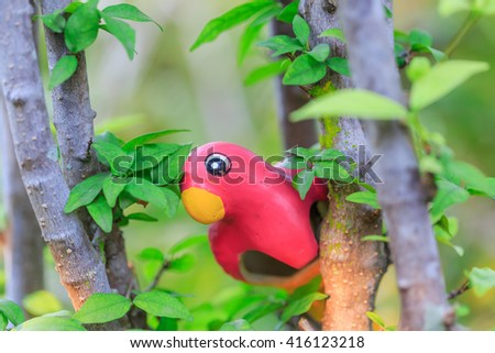 parrot doll on the tree - stock photo