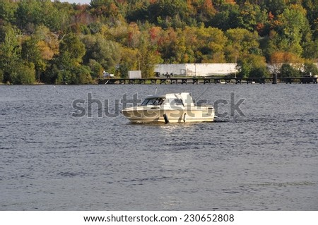 Parry Sound, Ontario, Canada - September 29, 2014: Sailboat returning in Parry Sound downtown harbour. - stock photo