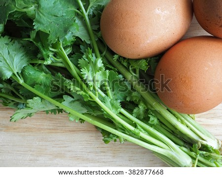 Parsley and eggs on a wooden chopping board