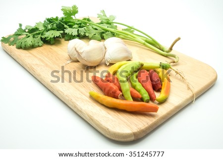parsley and garlic and chilli on the wood tray on white background