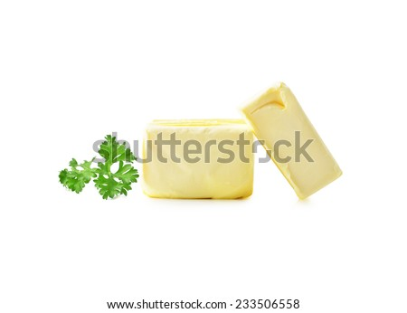 parsley and Stick of butter isolated on white. - stock photo