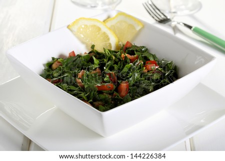parsley salad with tomato on ceramic jar - stock photo
