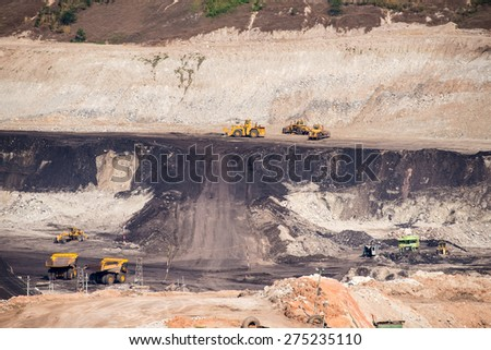 Part of a coal mine pit with big mining truck working  - stock photo
