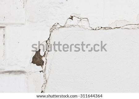 Part of a damaged white wall - stock photo