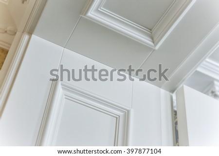 part of a doorway of a white door - stock photo
