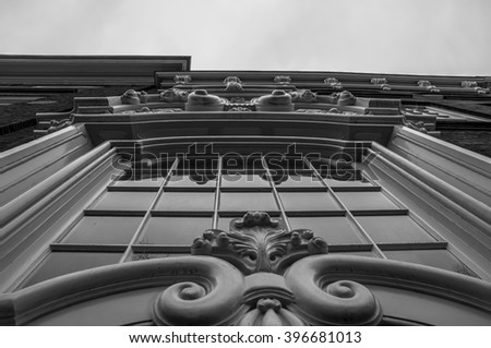 Part of a facade of a historical building in Delft the Netherlands. Great design of a glass and wood. Presented in black and white.