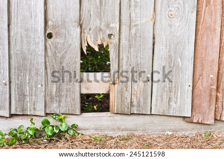 Part of a fence with a broken panel - stock photo