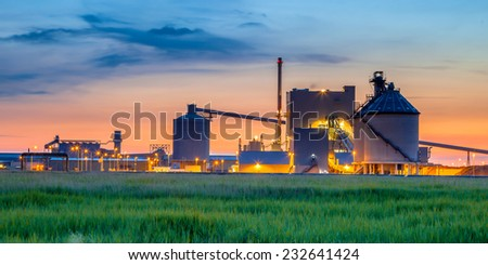 Part of a heavy Industrial Chemical area with surreal fantasy colors in twilight - stock photo