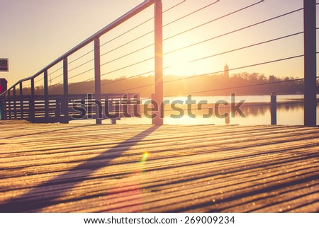 Part of a Jetty at Sunrise - stock photo