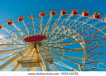 part of a large Ferris wheel on a background of blue sky - stock photo