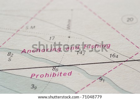 Part of a marine chart showing a prohibited anchoring and fishing area - stock photo