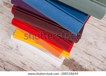 Part of a pile of books with different colors