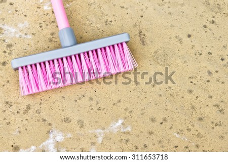 Part of a pink plastic toy broom - stock photo