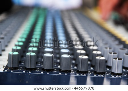 Part of a professional sound mixing console, studio music device for audio signals with controlling knobs - stock photo