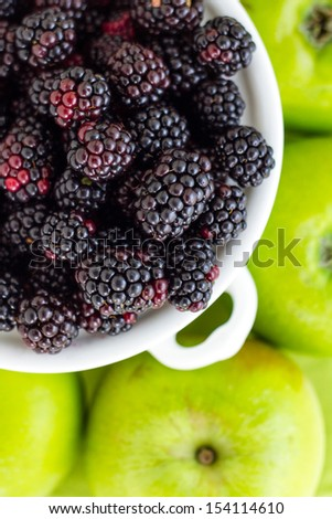 Part of a series showing the preparation of Apple and Blackberry Pie. - stock photo