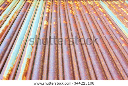 Part of a severly rusted corrugated metal door as a background, with shallow depth of  field - stock photo