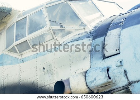 Part of a small blue and white plane on a background of blue sky