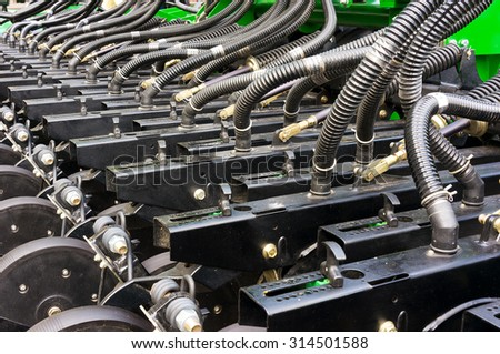 Part of a sowing machine - stock photo