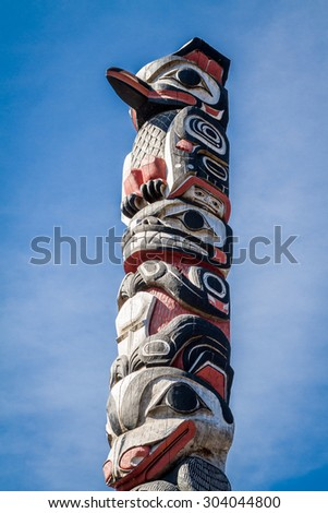 Part of a totem pole at the front entrance of the Icy Strait Point Hoonah Tlingit Cultural Center Theater near Hoonah, Alaska on Chichagof Island.