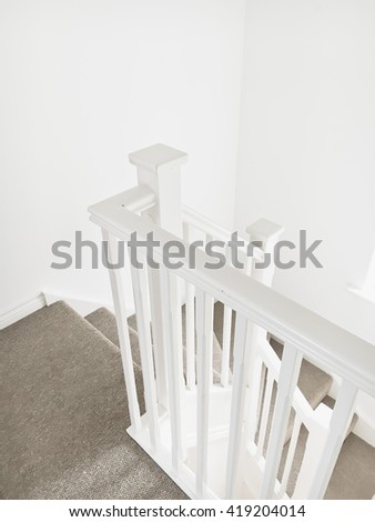 Part of a white wooden bannister in a modern home - stock photo