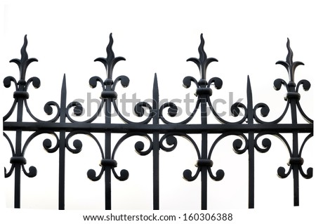 part of a wrought iron fence on white background - stock photo