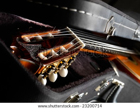 Part of acoustic guitar. Guitar lying in the case - stock photo