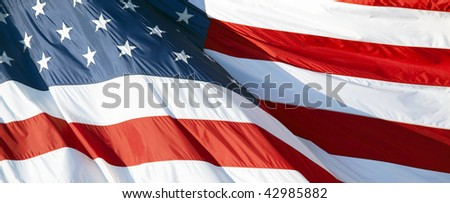 Part of American flag waving in the wind - stock photo