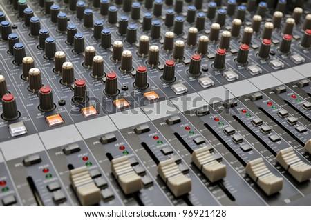 Part of an audio sound mixer - stock photo
