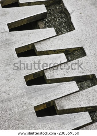 Part of an expansion joint (which can absorb heat-induced expansion and allow movement in an earthquake) between sections of a large bridge in Mount Rainier National Park, Washington, USA