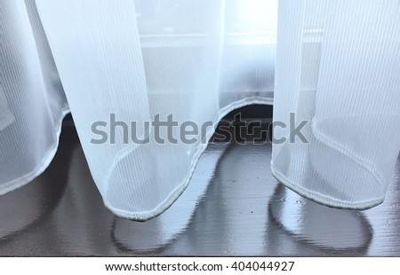 Part of an interior net curtain