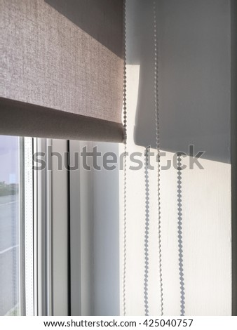 Part of an interior pull blind with strong sunlight