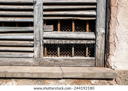 part of an old, weathered wooden window in natural colors - stock photo