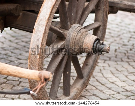 Part of ancient cart with wooden wheels - stock photo