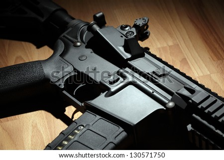 Part of AR-15 (M4A1) carbine in a light beam - stock photo