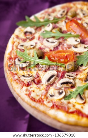 Part of baked pizza with colorful stuffing - stock photo