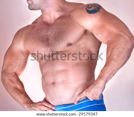Part of beautiful male torso. Isolated on pink. Side view - stock photo