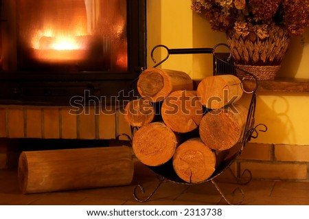 Part of blazing fireplace with few logs ahead - stock photo