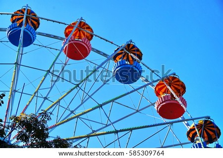 Part of blue and red ferris wheel. Sunny day in Belgorod, Russia