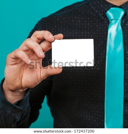 Part of body of business man who takes out business card from the pocket of business suit, copyspace - stock photo