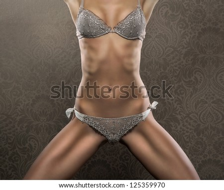 Part of body of sexy woman in erotic lingerie - stock photo
