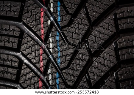 Part of brand new modern winter car tire - stock photo