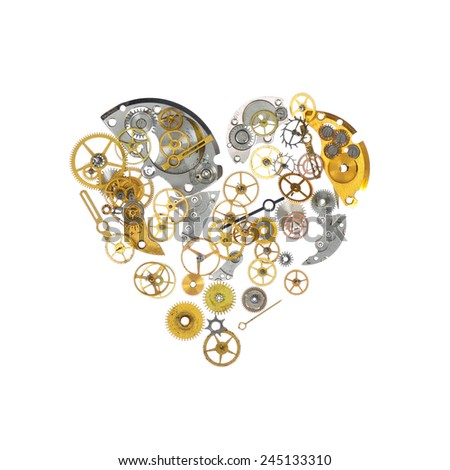 Part of broken watch shaped as heart - stock photo